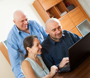 Advisor   near mature couple with laptop Stock Images