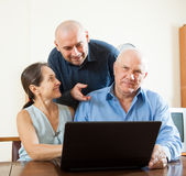 Advisor  standing near mature couple Stock Photography