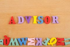 ADVISOR word on wooden background composed from colorful abc alphabet block wooden letters, copy space for ad text stock photos