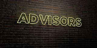 ADVISORS -Realistic Neon Sign on Brick Wall background - 3D rendered royalty free stock image Stock Images