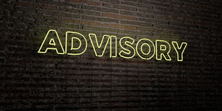 ADVISORY -Realistic Neon Sign on Brick Wall background - 3D rendered royalty free stock image. Can be used for online banner ads and direct mailers Stock Photography