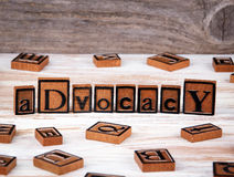 Advocacy from wooden letters. On wooden background royalty free stock image