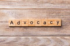 ADVOCACY word written on wood block. ADVOCACY text on wooden table for your desing, concept.  royalty free stock photography