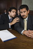 Advocate Discussing With Client. Lawyer discussing points with client in the courtroom Stock Images