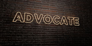 ADVOCATE -Realistic Neon Sign on Brick Wall background - 3D rendered royalty free stock image. Can be used for online banner ads and direct mailers Royalty Free Stock Image