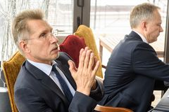Advocate Saulvedis Varpins left. 20.02.2018. RIGA,LATVIA. Press conference of Ilmars Rimsevics, Governor of Central Bank of Latvia. Hotel Gutenbergs, Riga Royalty Free Stock Images