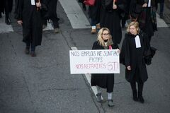 Lawyers with black dress protesting against the pension reform from the government