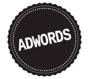 ADWORDS文本,在黑贴纸邮票 库存照片