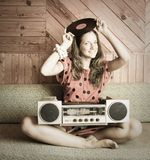 Ady On Sofa And Vintage Record Player Royalty Free Stock Image