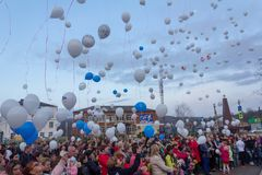 People are launching into the sky white balloons on the day of mourning for those killed in a fire in the city of Kemerovo. Adygea, Russia - March 28, 2018 Stock Photos