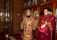 The Archbishop and archdeacon serve at the divine Liturgy in the Orthodox Church Stock Photography