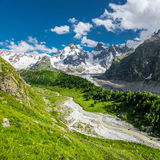 Adyl-Su gorge. Beautiful green Adyl-Su gorge with a rough river in sunny summer day. Greater Caucasus mountains, Kabardino-Balkaria, Elbrus region royalty free stock photography