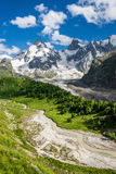 Adyl-Su gorge. Beautiful green Adyl-Su gorge with a rough river in sunny summer day. Greater Caucasus mountains, Kabardino-Balkaria, Elbrus region royalty free stock image