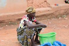 Traditional medicine saleswoman. Stock Image