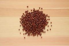 Adzuki, aduki or azuki beans on wood Royalty Free Stock Images