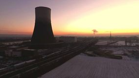 Aearial drone winter nuclear power plant sunset sunrise dawn landscape stock footage