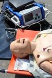 AED-Attrappe - medizinische Puppe Stockfotografie