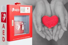 AED or Automated External Defibrillator first aid help heart. AED or Automated External Defibrillator first aid help giving life heart concept stock images