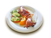 Aegean Barbecued Calamari in the White Dish. With lemon, tomatoe and cucumber stock images