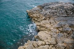 Aegean coast in Turkey, stone rocks and blue water. Shot from above stock photography