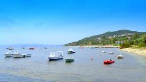 Aegean sea beach boats Greece Stock Photo