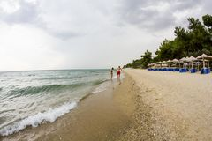 Aegean sea, beach and sky with clouds before the storm. Fish eye lens effect royalty free stock photography