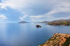 Aegean sea, Cape Sounion, Attica, Greece. Beautiful view from the Cape Sounion on the Aegean sea, island and dramatic cloudy sky, Attica, Greece stock photos