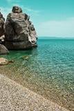 Aegean Sea, Chalkidiki, Kassandra. Landscape with coastal cliffs. And calm sea on a sunny day. Seascape stock photos