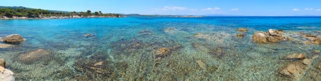 Aegean sea coast Chalkidiki, Greece. Aegean sea coast landscape, view near Karidi beach Chalkidiki, Greece. Panorama. People are unrecognizable stock photos