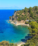 Aegean sea coast Chalkidiki, Greece. Aegean sea coast landscape with aquamarine water and Mount Athos in mist Chalkidiki, Greece. Three shots stitch image Stock Image