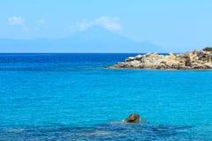 Aegean sea coast Chalkidiki, Greece. Aegean sea coast landscape with aquamarine water and Mount Athos in mist, view near Karidi beach Chalkidiki, Greece Stock Photography