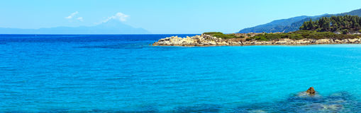 Aegean sea coast Chalkidiki, Greece. Aegean sea coast landscape with aquamarine water and Mount Athos in mist, view near Karidi beach Chalkidiki, Greece. Three Royalty Free Stock Photo