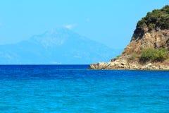 Aegean sea coast Chalkidiki, Greece. Aegean sea coast landscape with aquamarine water and Mount Athos in mistChalkidiki, Greece Stock Images