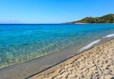 Aegean sea coast Chalkidiki, Greece. Aegean sea coast landscape with aquamarine water, view from Armenistis beach Chalkidiki, Greece Stock Photography