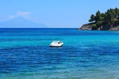 Aegean sea coast Chalkidiki, Greece. Aegean sea coast landscape with motor boat in bay, view near Karidi beach Chalkidiki, Greece Stock Photos