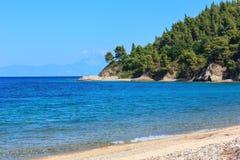 Aegean sea coast Chalkidiki, Greece. Aegean sea coast landscape and Mount Athos in mist Sithonia, Chalkidiki, Greece Stock Images