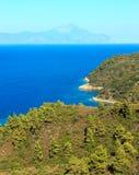 Aegean sea coast Chalkidiki, Greece. Aegean sea coast landscape and Mount Athos in mist Chalkidiki, Greece. Three shots stitch image Stock Image