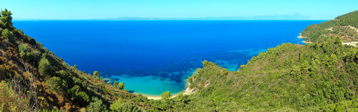 Aegean sea coast Chalkidiki, Greece. Aegean sea coast landscape and Mount Athos in mist Chalkidiki, Greece. Three shots stitch panorama Royalty Free Stock Image