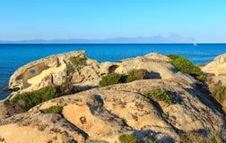 Aegean sea coast Chalkidiki, Greece. Aegean sea coast landscape and Mount Athos peninsula in mist, view from Orange Beach Chalkidiki, Greece Royalty Free Stock Images