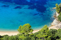 Aegean sea coast Chalkidiki, Greece. Aegean sea coast landscape with sandy beach Chalkidiki, Greece Stock Photos