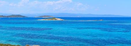Aegean sea coast Chalkidiki, Greece. Aegean sea coast landscape, view near Karidi beach Chalkidiki, Greece. People are unrecognizable. Two shots stitch panorama Royalty Free Stock Images