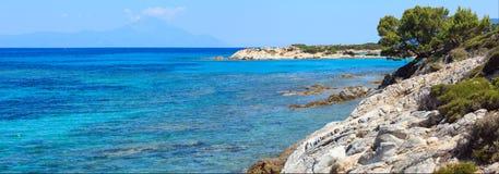 Aegean sea coast Chalkidiki, Greece. Aegean sea coast landscape, view near Karidi beach Chalkidiki, Greece. Two shots stitch high-resolution panorama Royalty Free Stock Photos