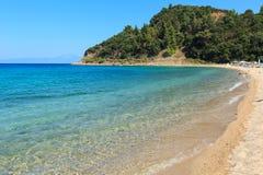 Aegean sea coast Chalkidiki, Greece. Aegean sea coast landscape, view from sandy beach Chalkidiki, Greece. Peoples unrecognizable Stock Photo