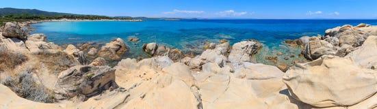 Aegean sea coast Chalkidiki, Greece. Aegean sea coast panorama and Karidi or Karydi beach Chalkidiki, Greece. People are unrecognizable royalty free stock photos