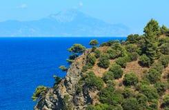 Aegean sea coast Chalkidiki, Greece. Aegean sea coast summer landscape and Mount Athos in mist Chalkidiki, Greece Stock Photo