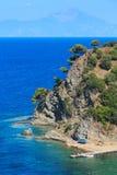 Aegean sea coast Chalkidiki, Greece. Summer Aegean sea coast landscape and Mount Athos in mist Chalkidiki, Greece Royalty Free Stock Photography