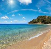 Aegean sea coast Chalkidiki, Greece. Aegean sea coast sunshiny landscape, view from sandy beach Chalkidiki, Greece. Two shots stitch high resolution image Royalty Free Stock Images