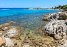 Aegean sea coast Chalkidiki, Greece. Vourvourou, Greece, July 22, 2016: Aegean sea coast landscape, view near Karidi beach Chalkidiki, Greece Royalty Free Stock Photos