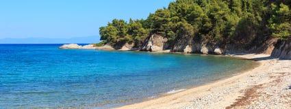 Aegean sea coast Chalkidiki, Greece. Aegean sea coast landscape with beach Sithonia, Chalkidiki, Greece. Two shots stitch  panorama Royalty Free Stock Photos