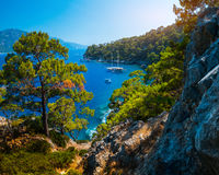 Aegean Sea coast. With lush pine trees and calm lagoons with anchored boats, Fethiye, Turkey Stock Image